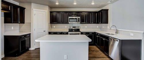 Trinity_Hubble_Homes_New_Homes_Boise_0003_Eagle Stream Trinity Traditional - Kitchen - 15109 N Bonelli Ave-3.jpg